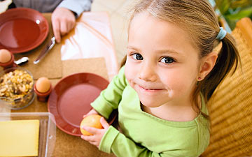 Catering for children: A small girl at the meal table