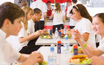 School catering: students at the meal table