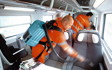 A cleaning service: Dussmann operatives clean train interiors